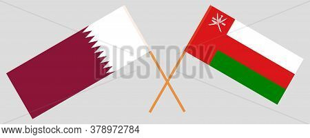 Crossed Flags Of Oman And Qatar. Official Colors. Correct Proportion. Vector Illustration