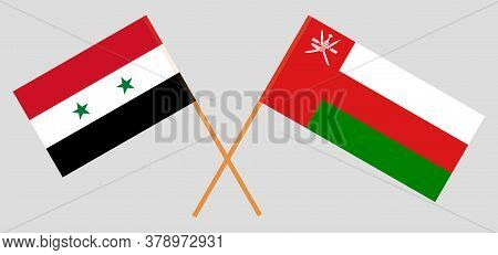 Crossed Flags Of Oman And Syria. Official Colors. Correct Proportion. Vector Illustration
