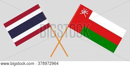 Crossed Flags Of Oman And Thailand. Official Colors. Correct Proportion. Vector Illustration