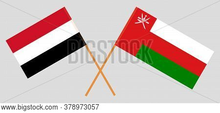 Crossed Flags Of Oman And Yemen. Official Colors. Correct Proportion. Vector Illustration
