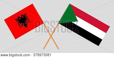 Crossed Flags Of Sudan And Albania. Official Colors. Correct Proportion. Vector Illustration