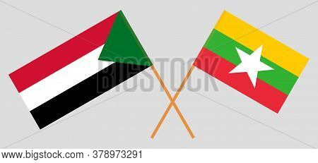 Crossed Flags Of Sudan And Myanmar. Official Colors. Correct Proportion. Vector Illustration