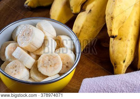 Banana Bunch, Sliced Bananas In Bowl And On Wooden Board.