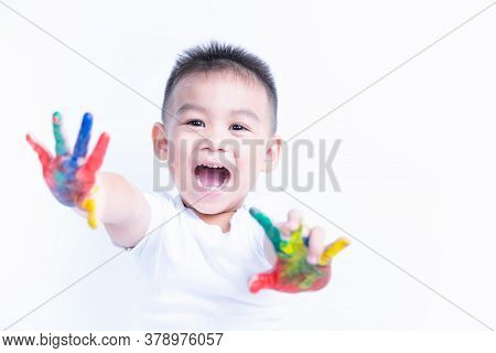 Portrait Of Asian Happy Little Baby Boy Happy Face Show Hand He Has Watercolor Or Finger Paint On Ha