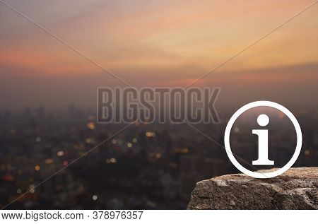Information Sign Flat Icon On Rock Mountain Over Blur Of Cityscape On Warm Light Sundown, Business C