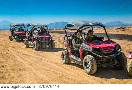 Hurghada, Egypt- Feb 4 , 2020:  Tourists  in safari trip through egyptian desert driving ATV. Quad bikes safari in the desert near Hurghada, Egypt.