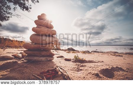 Zen Stones Stacked At Sea With Backlight