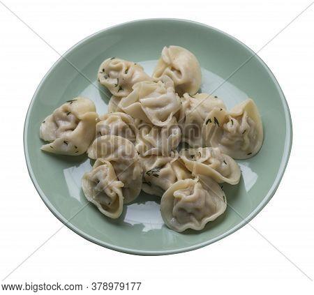 Dumplings On Light Green Plate Isolated On White Background .boiled Dumplings.meat Dumplings Top Vie