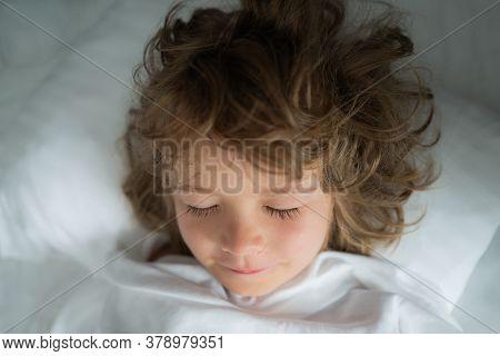 Adorable Kids Sleep. Child On Sleeping Bed, Happy Bedtime In White Bedroom