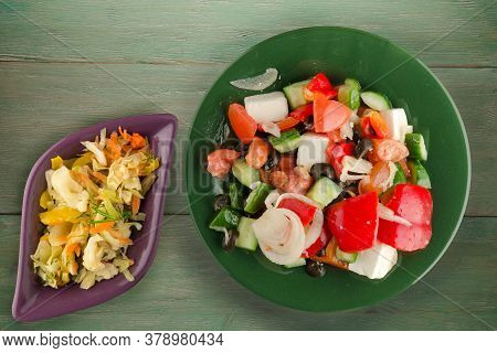 Greek Salad On Green Wooden Background . Greek Salad On Green Plate With Vegetarian Salad Top View .