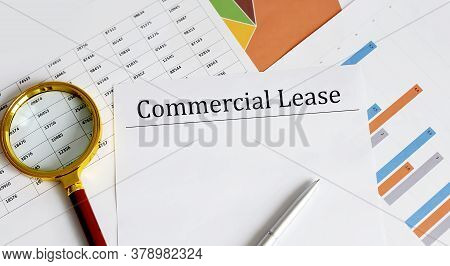 Paper With Commercial Lease On A Table With Chart,pen And Magnifier