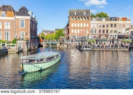 Leiden, Netherlands - July 21, 2020: Cityscape Leiden View From Catharinabridge With Waterways , Sho