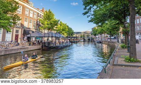 Leiden, Netherlands - July 21, 2020: Cityscape Leiden View New Rhine And Koren Brug With Waterways ,