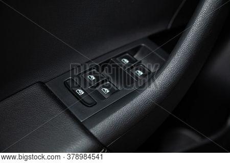 Novosibirsk/ Russia - July 18 2020: Scoda Rapid, Close-up Of The Side Door Buttons: Window Adjustmen