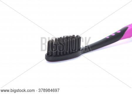 Charcoal Toothbrush On A White Background That Cleans Teeth With Charcoal, Designed For Health-consc