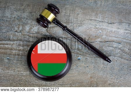 Wooden Judgement Or Auction Mallet With Of Oman Flag. Conceptual Image.
