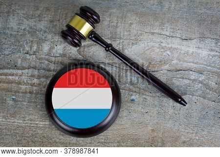Wooden Judgement Or Auction Mallet With Of Luxembourg Flag. Conceptual Image.