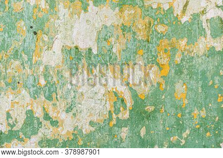 Old Wall With Peeling Paint Green. Old Textured Concrete Wall Painted Green Color.