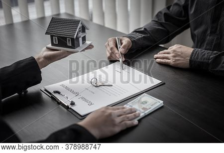 Real estate agent or sales manager has offered home sales and explained the terms of signing the hou