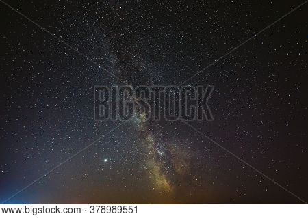 Night Starry Sky With Glowing Stars. Bright Glow Of Planets Saturn And Jupiter In Sky Among The Milk