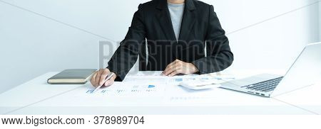 Businesswomen Bookkeeper Use Calculator And Laptop Doing Account For Paying Tax On White Desk In Wor