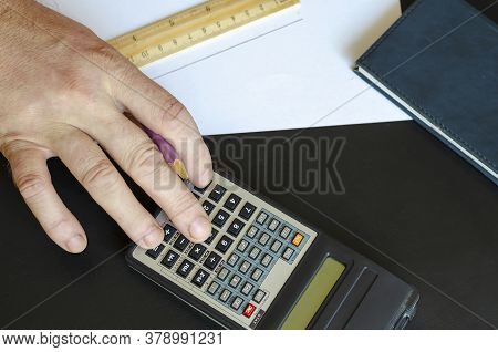 Male Hand Counts On The Calculator The Amount Of Materials For Water Supply.