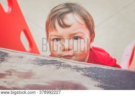 Portrait Of Cute Little Boy In Red T-shirt Excitedly Playing On Playground. Concept Of Happy Healthy