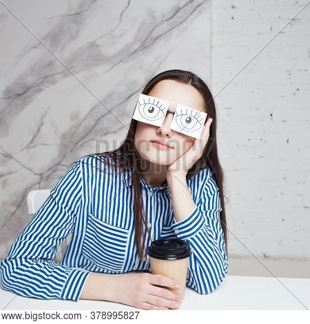 Drowsiness And Procrastination. A Student Pretends To Work, A Girl In Glasses With Stickers With A P