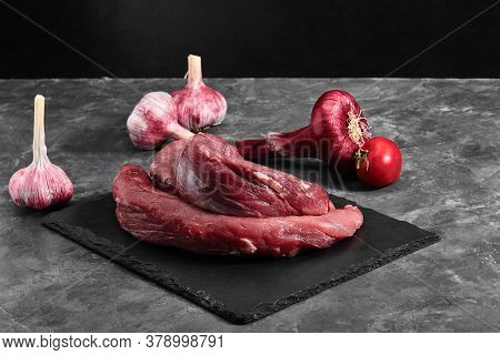 Beef Raw Fillet Tenderloin On Black Marble Background