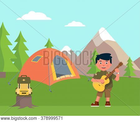 Happy Boy Scout Playing Guitar. Tent, Backpack On Stump. Overnight Stay Place. Fun And Rest In Mount