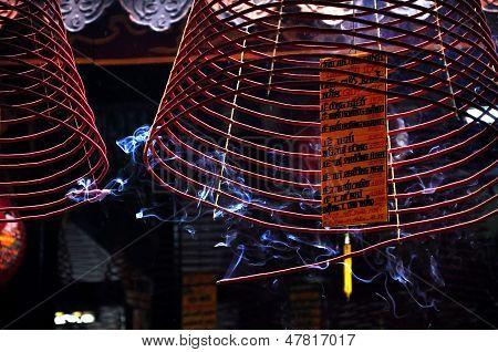 Burning incense coils. Hoi An, Vietnam