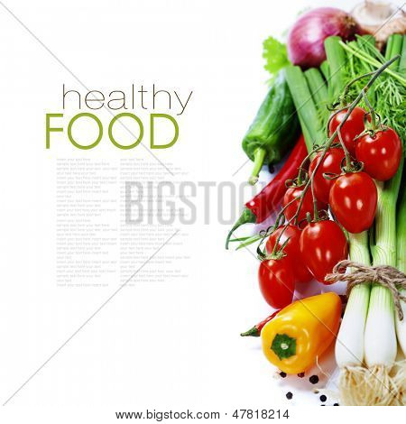 fresh vegetables on the white background - healthy or vegetarian eating concept (with easy removable sample text)
