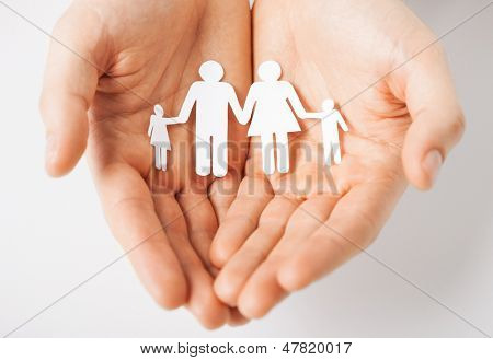 man hands showing family of paper men