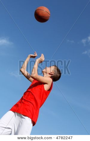 Fit Healthy Kid Or Child Playing Basketball