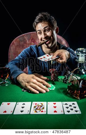 Photo of cheerful and successful poker player poster