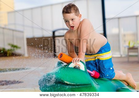 Child playing with water toy at kiddie pool during summer