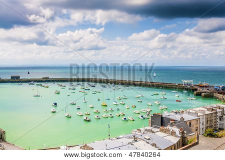 View of the port of Granville with houses boats harbor wall and wharf Upper Normandy France poster