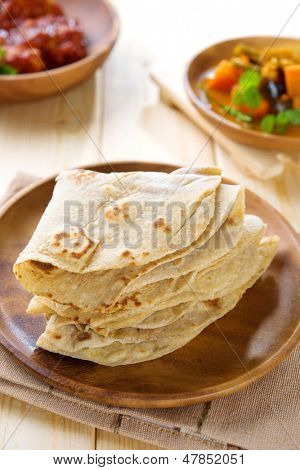 Chapati or chapatti, Indian dhal and chicken curry, popular Indian food. poster