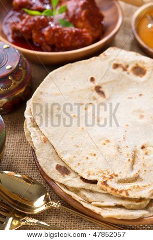 Chapati or Flat bread, Indian chapatti, dhal and chicken curry, popular Indian food.