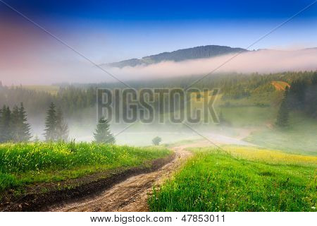 Crossroads In The Morning Mist In Mountains