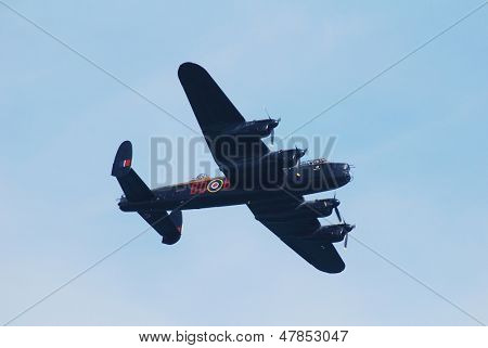 EASTBOURNE, ENGLAND - AUGUST 11: Avro Lancaster bomber PA474 of the Battle of Britain Memorial Flight, performs at the Airbourne airshow on August 11, 2012 in Eastbourne, East Sussex.