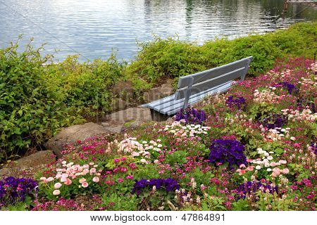 Bench And Flowers At Alpen Lake In Montreux (Switzerland)