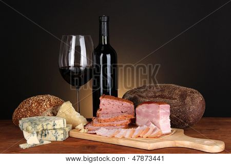 Exquisite still life of wine, cheese and meat products poster