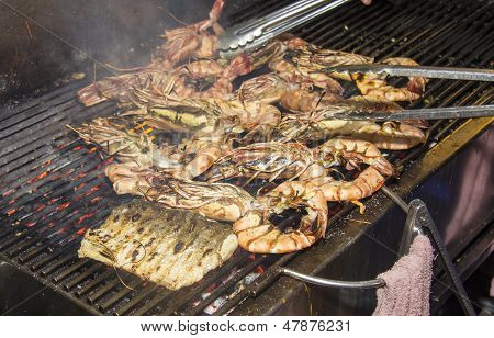 poster of Prawns being cookoed on a grill outside a restaurant in Hua Hin Thailand