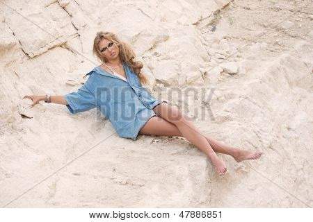 Girl In Oversize T-shirt Over Stone-pit Background
