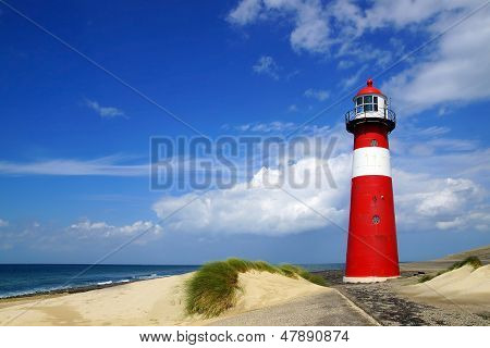 Lighthouse on the blue sky background.