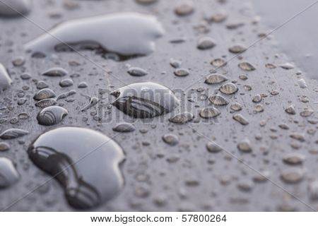 Raindrops pattern on wooden deck close up poster