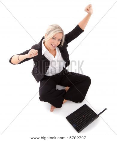 Beautiful Businesswoman Punches The Air on laptop