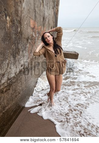 Woman Near Concrete Constructions On The Sea Shore