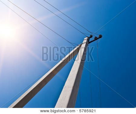 Electric Column Against The Blue Sky